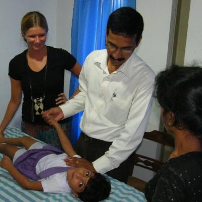 A Projects Abroad intern is pictured watching over a doctor as part of their physiotherapy internship in Sri Lanka.